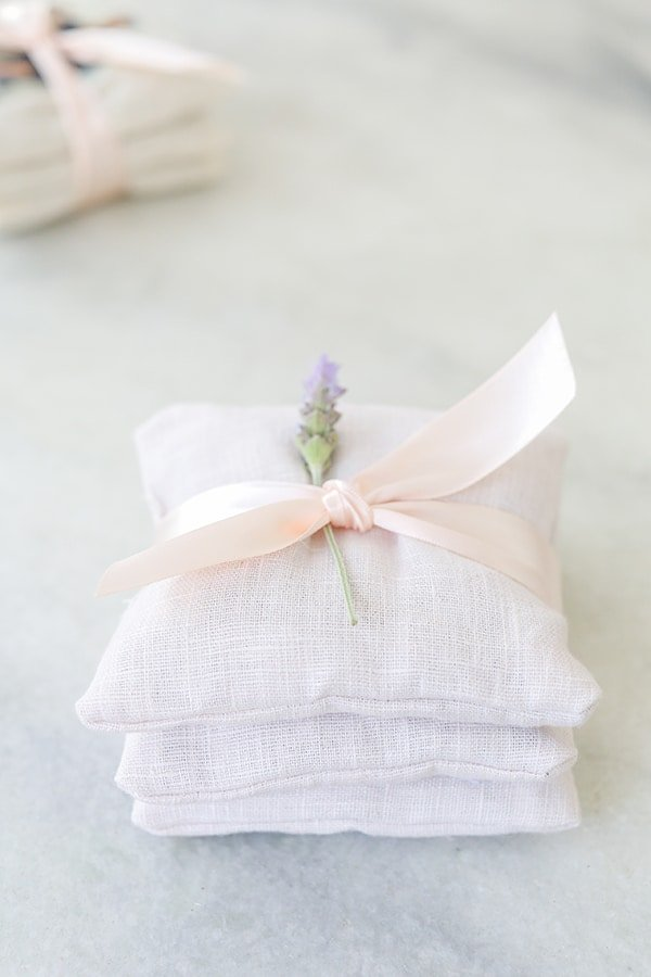 Charming DIY Lavender Sachets made with pink linen fabric and tied with a bow.