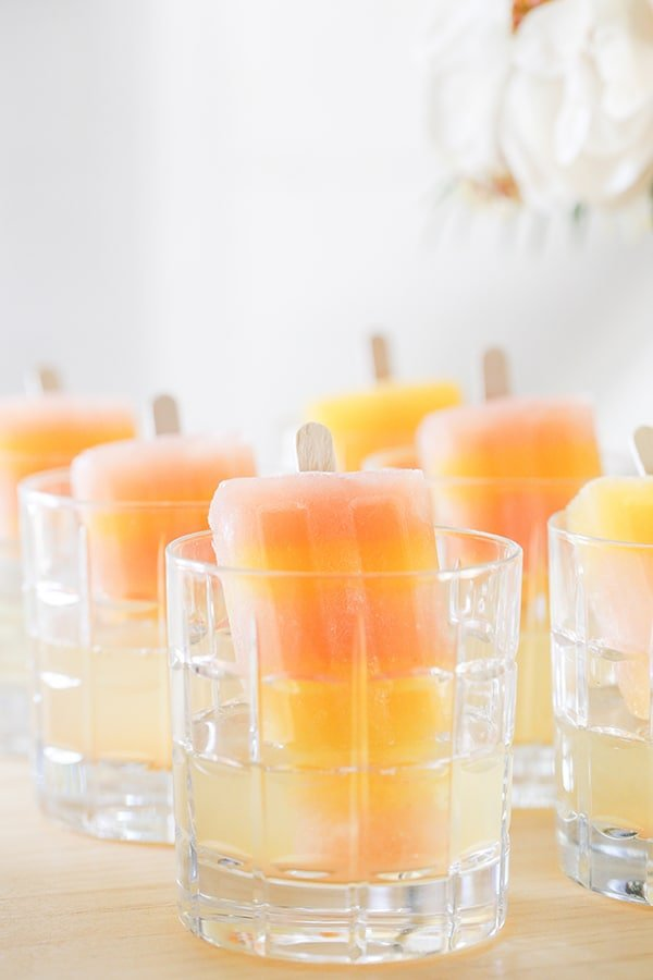 Striped greyhound popsicles in a glass with champagne