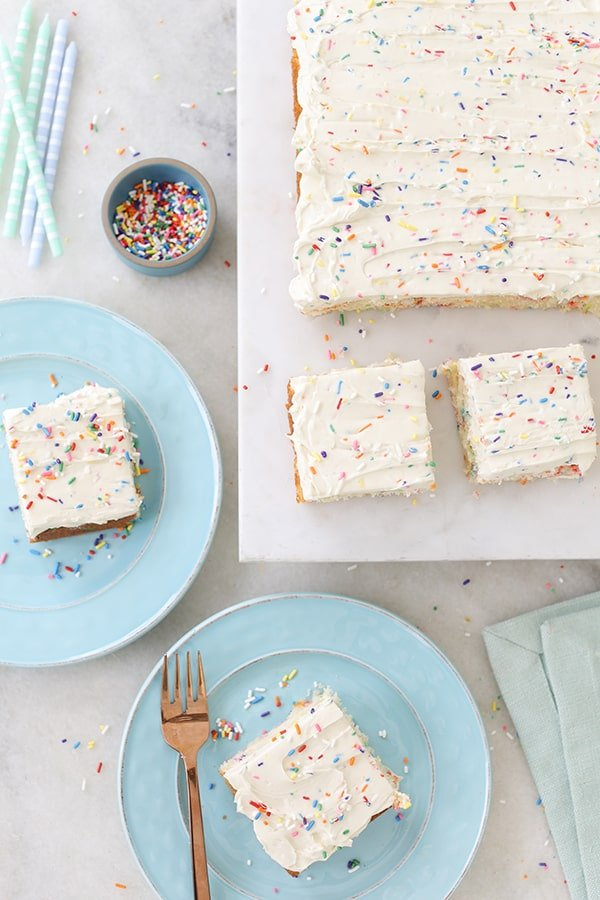 top down shot of funfetti sheet cake with slices cut out