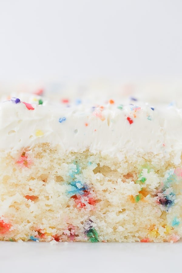 close up shot of slice of funfetti sheet cake