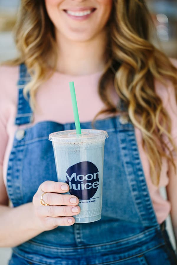 Eden Passante holding Moon Juice smoothie