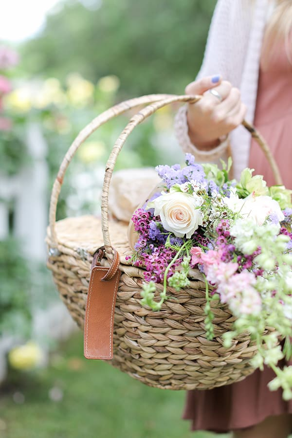 Mother's Day picnic basket with flowers.
