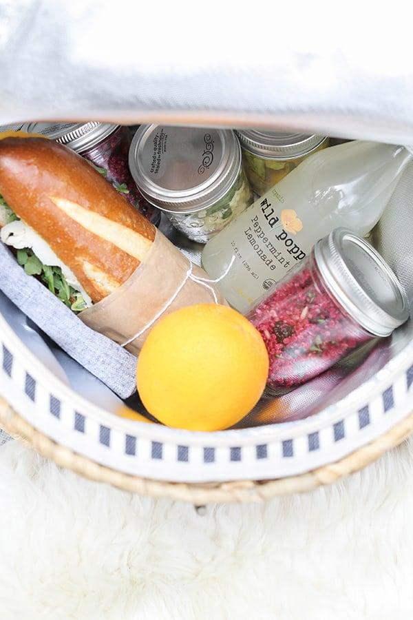 Picnic food inside a picnic basket.