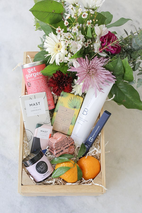 a beauty box with flowers and beauty products