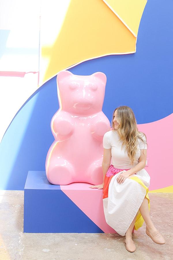 Eden Passante sitting next to a gummy bear.
