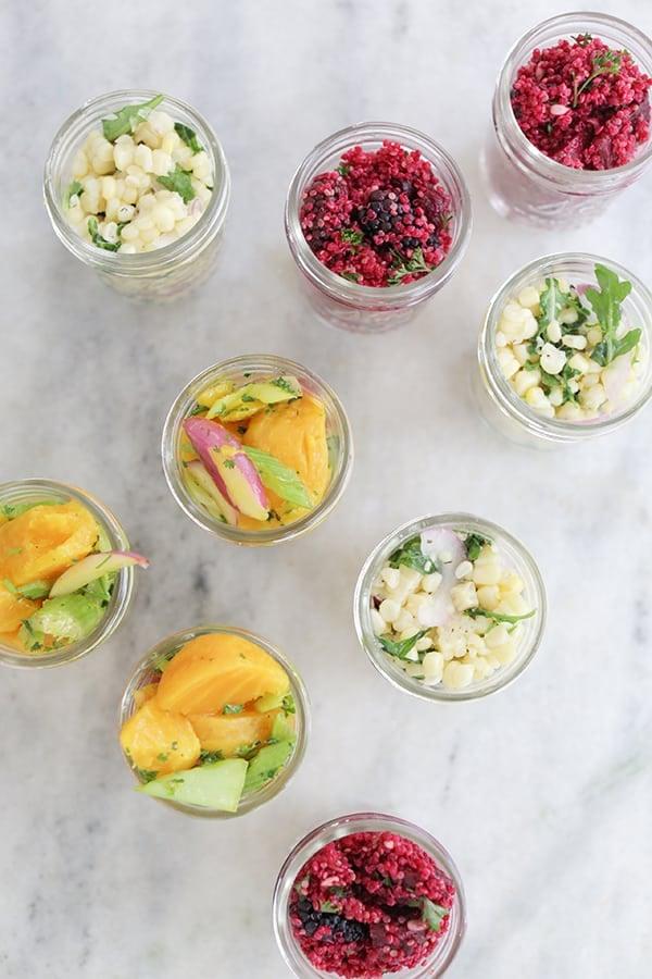 Vegetable salad in mason jars.