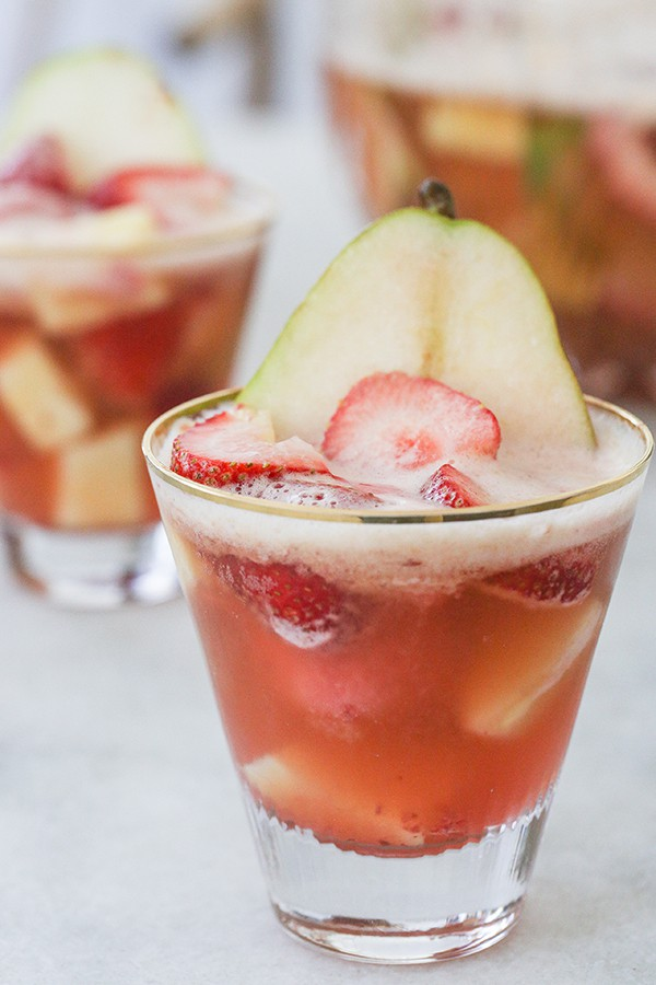 Sherbet punch in a glass with sliced pear and strawberry