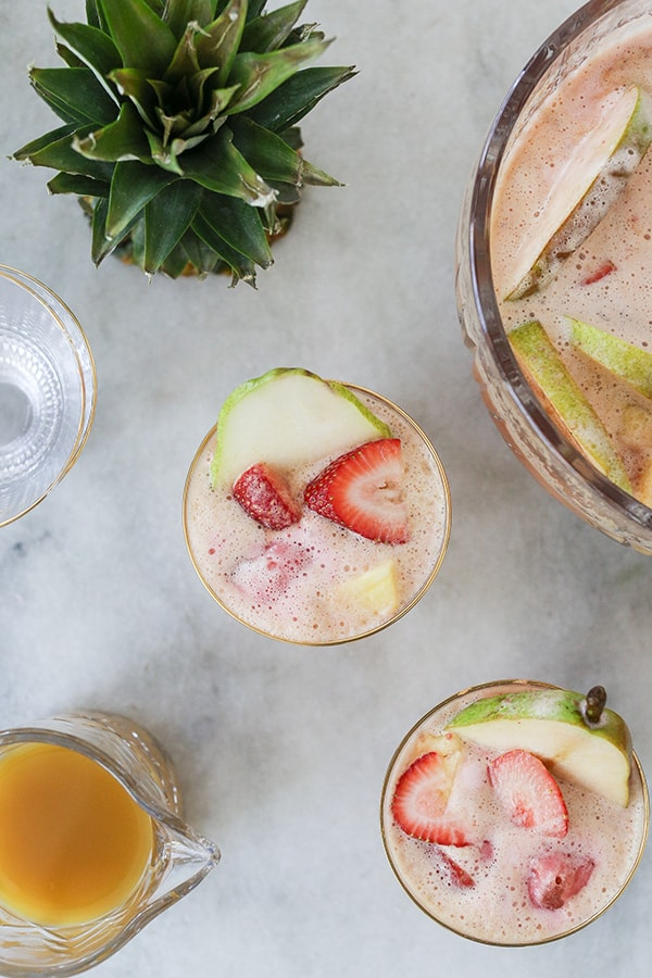 Sherbet punch in glasses with sliced fruit