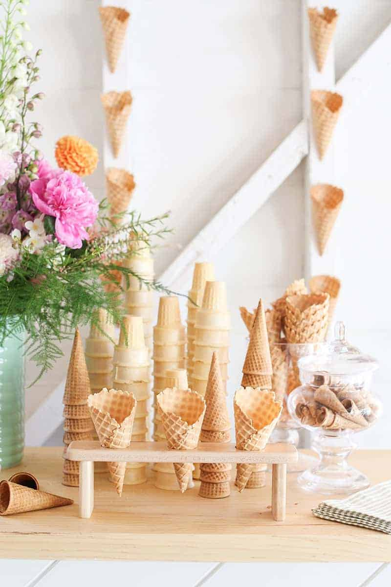 All different ice cream cones on an ice cream bar.