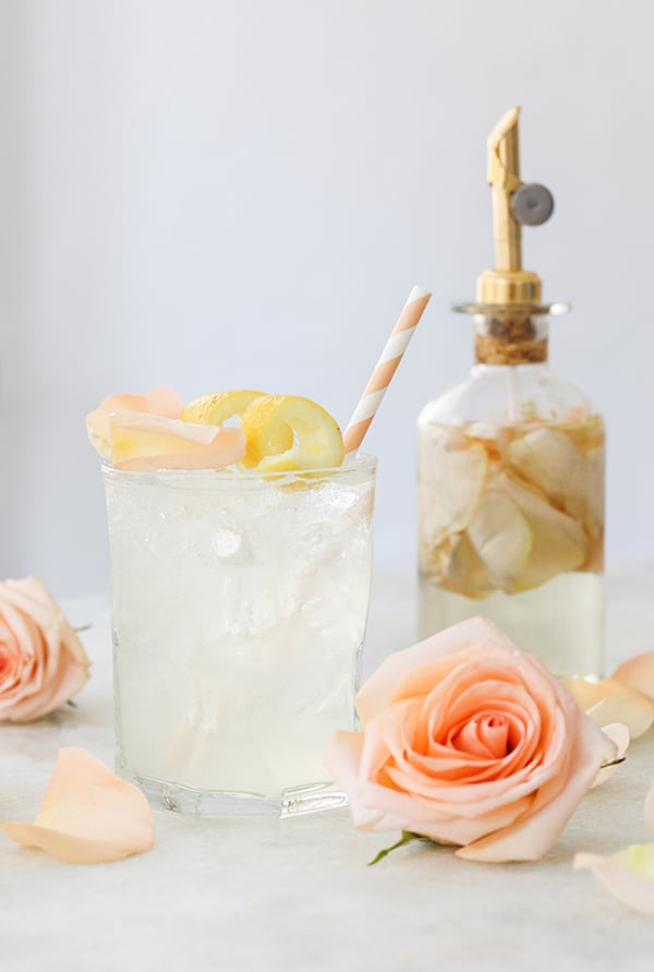 Rose water cocktail with a rose and lemon slice