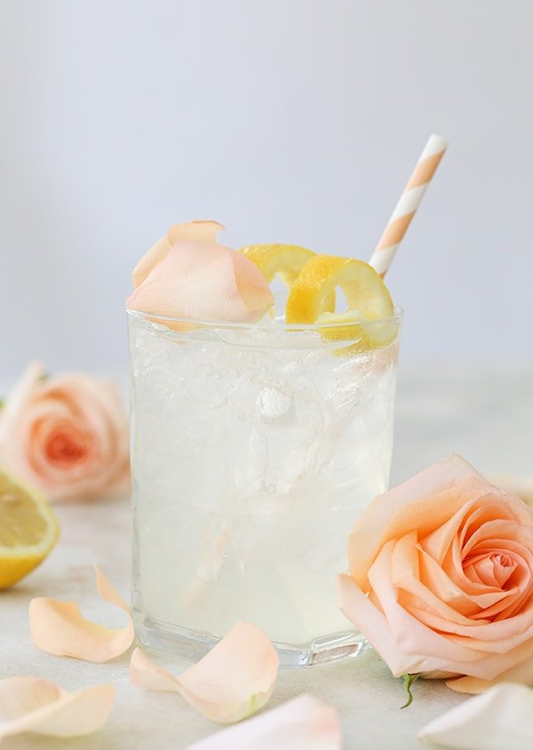A beautiful rose water cocktail with lemon and rose