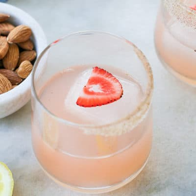 garnishing a cocktail with a strawberry is so charming