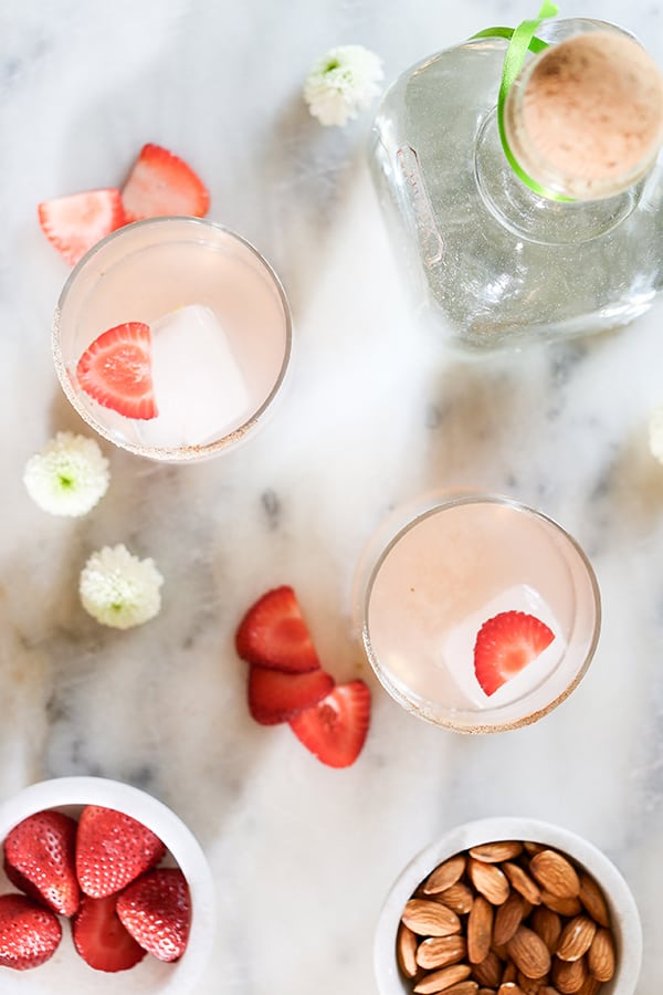 Strawberry cocktail with strawberries and a bottle of Patron.