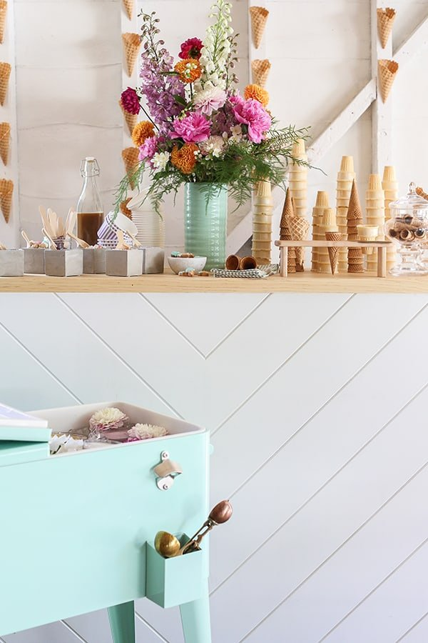Ice cream bar with cones, flowers, toppings and a waffle cone bar