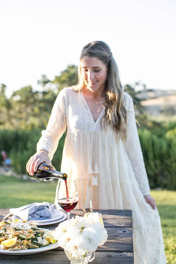 Eden Passante pouring wine in Los Olivos.