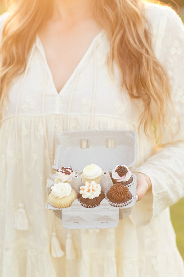 Holding mini cupcakes in egg holders.