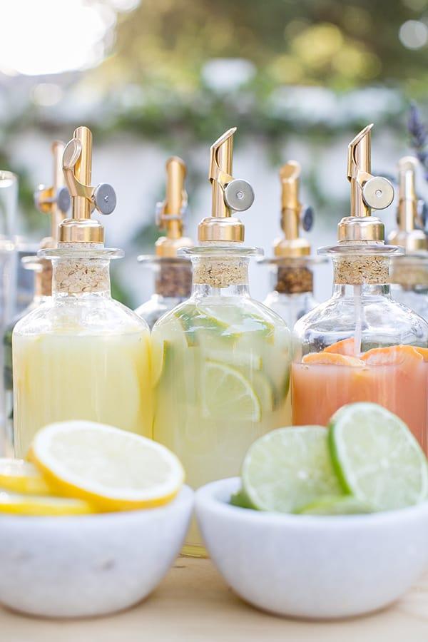 Fresh lemon juice, fresh lime juice and fresh juice in bottles.