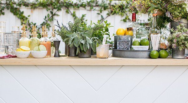 Cocktail Garden Bar with fresh herbs, flowers, cocktails and ingredients to make cocktails.