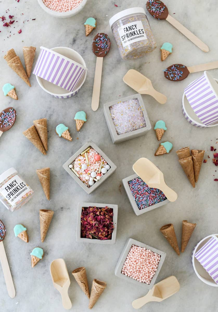 ice cream bar toppings on a marble table