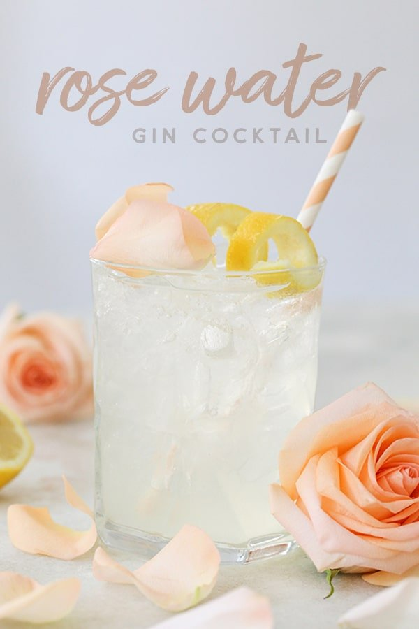 Cocktail with roses and lemon slice.