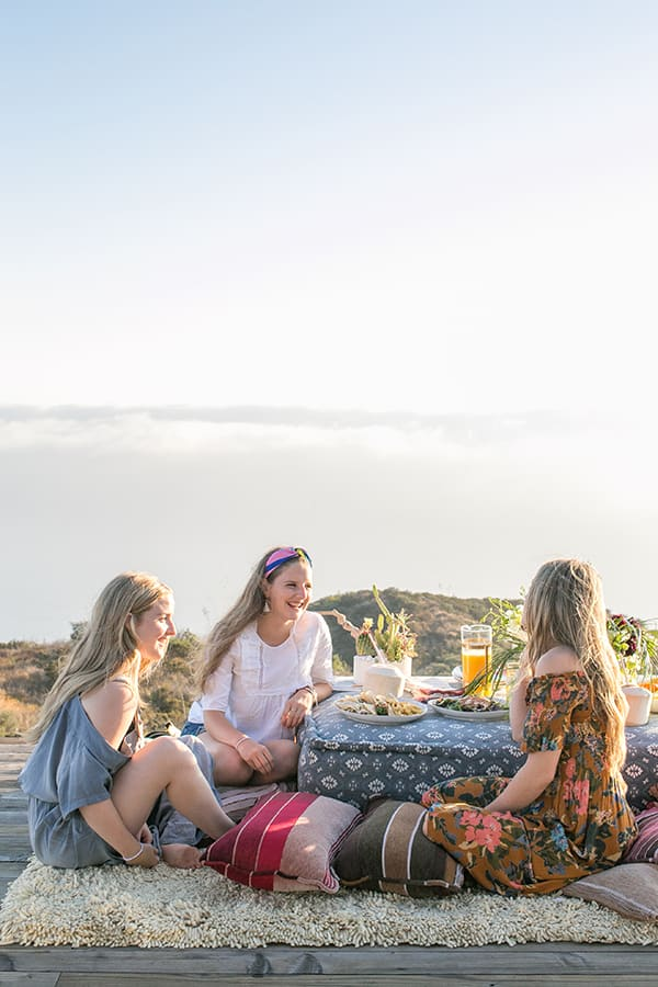 Girls sitting around a table in Malibu.