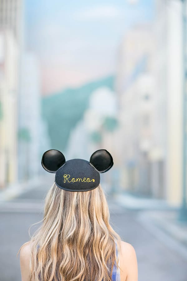 eden wearing a mickey mouse hat at Disneyland