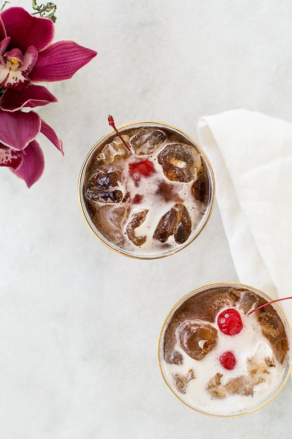 Coffee tonic recipe with a cherry and filled with ice