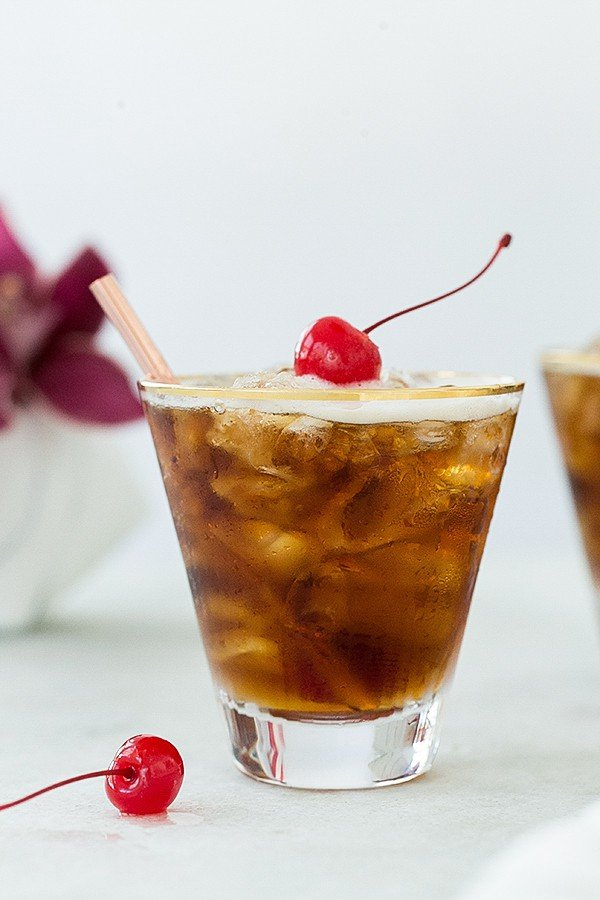 Coffee tonic with a red cherry.