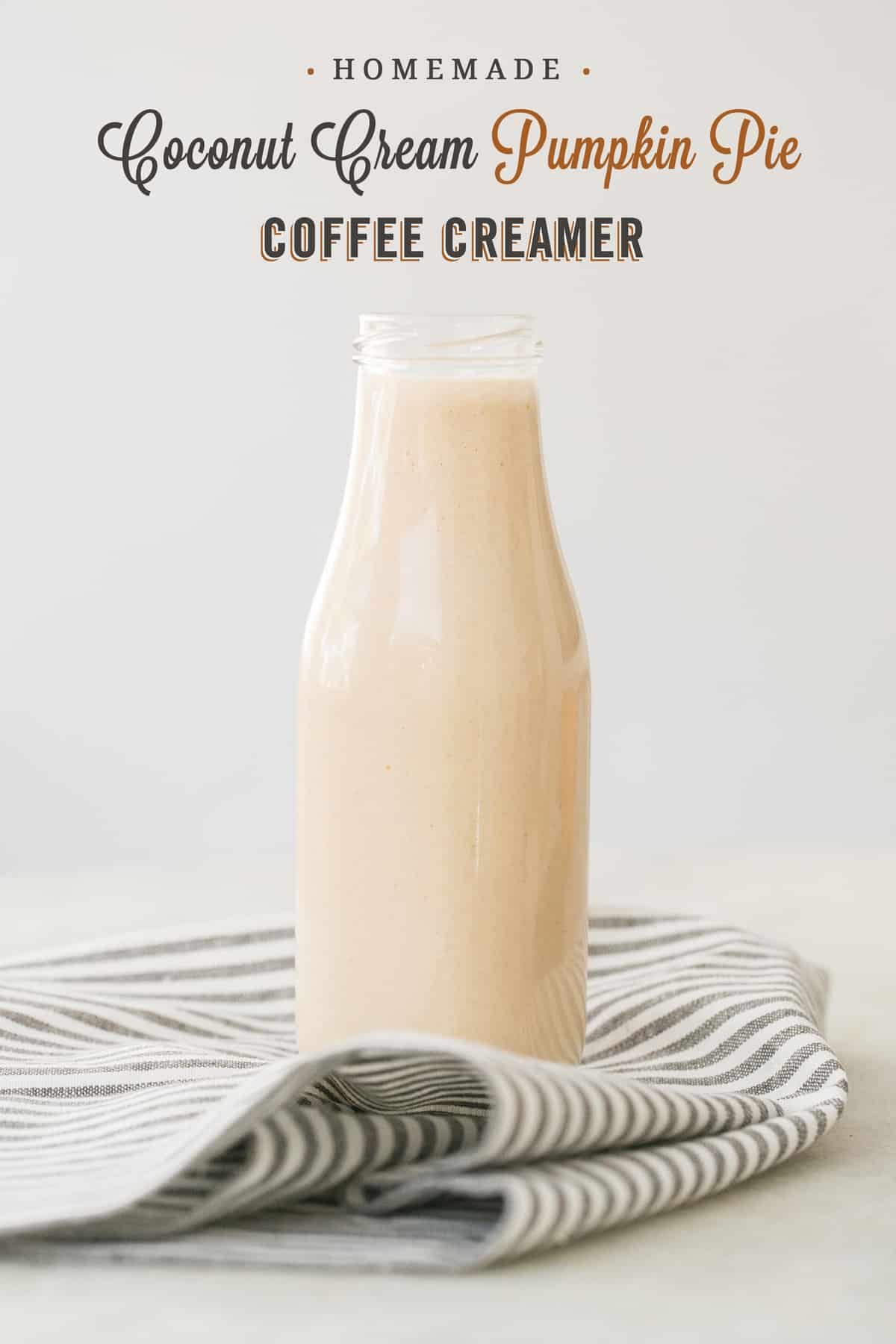 shot of coffee creamer in a glass bottle