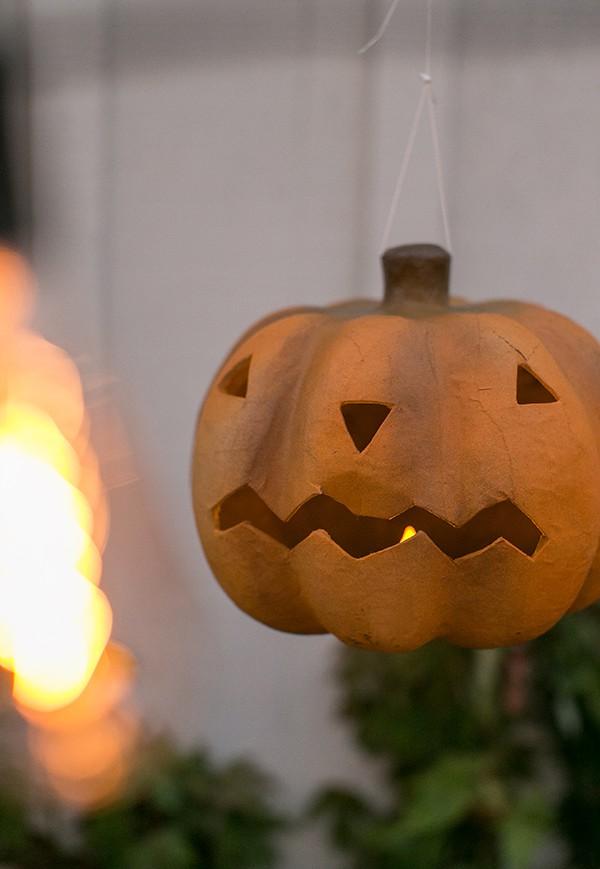 shot of jack o lantern at night at vintage Halloween party