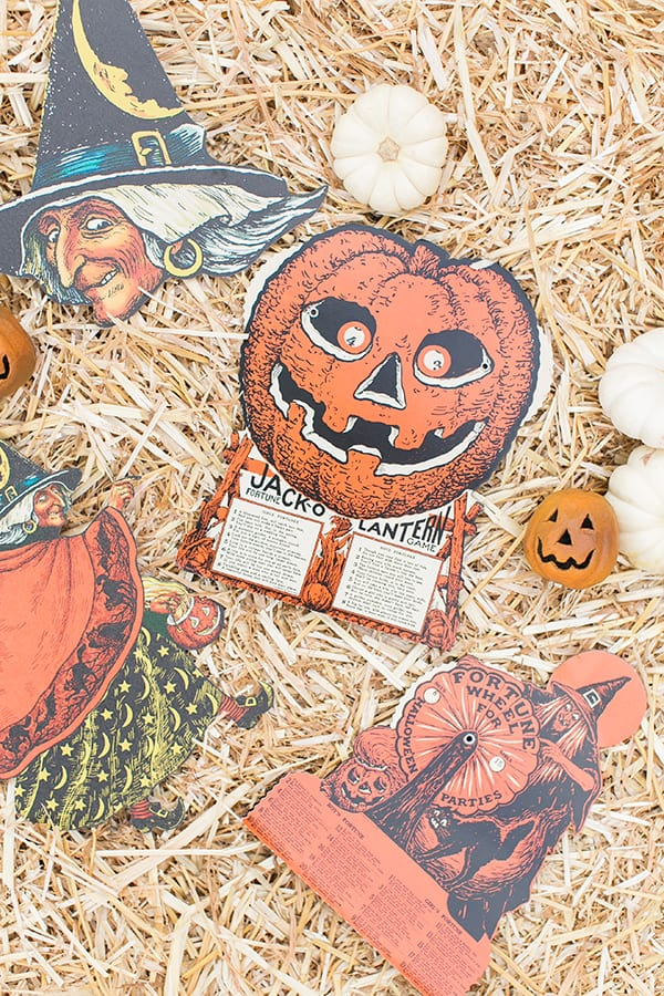vintage Halloween games and decor on a hay bale