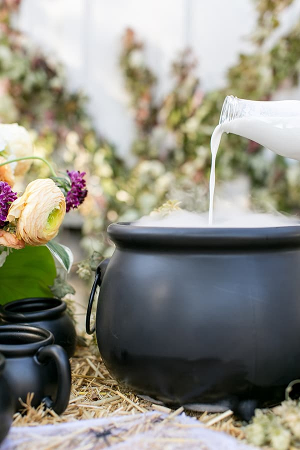 side shot of a big cauldron with cream being poured in