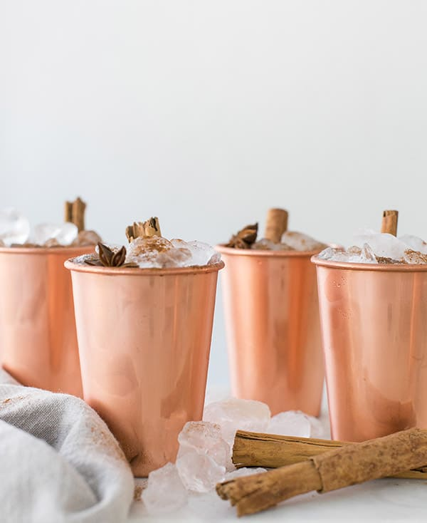 shot of copper mugs with finished drinks in them