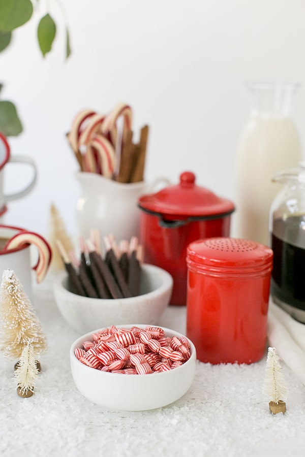 Peppermint in a small bowl with chocolate candy cane sticks