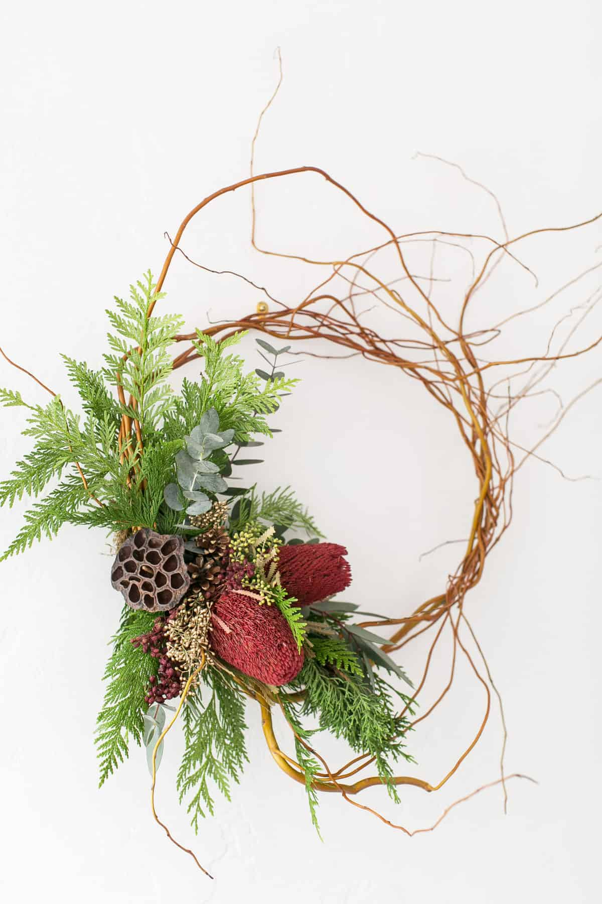 wicker wreath with green