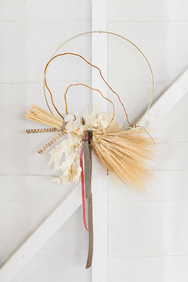 shot of thanksgiving decoration of wrapped wheat, on a wall