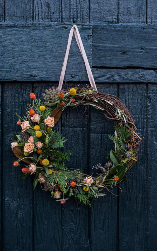 beautiful brown wicker wreath with flowers