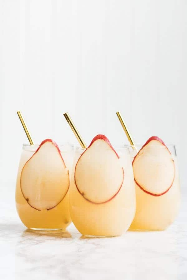 three glasses of pear champagne cocktail.