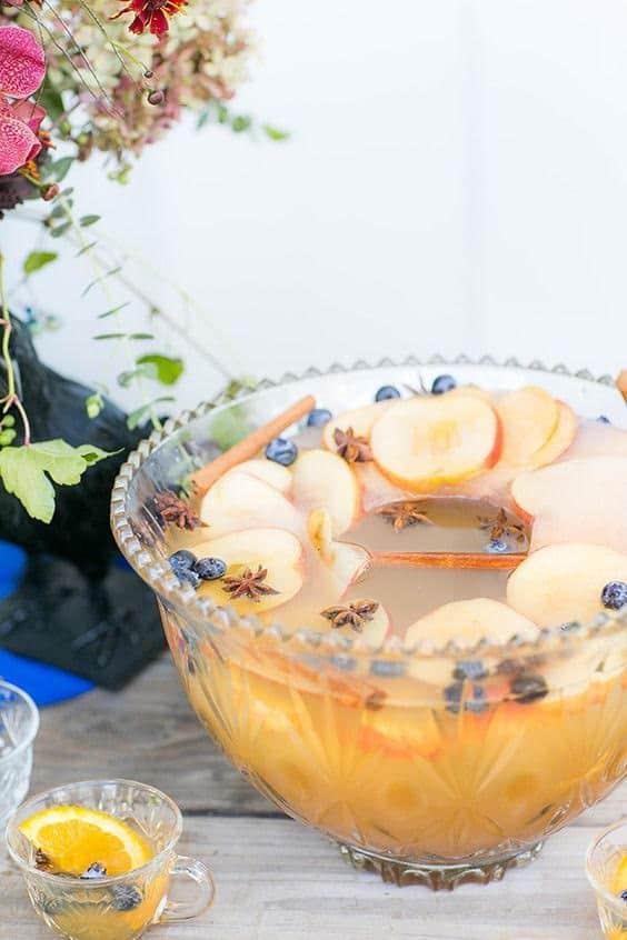 Spiked apple cider punch in a punch bowl with apple ice ring.