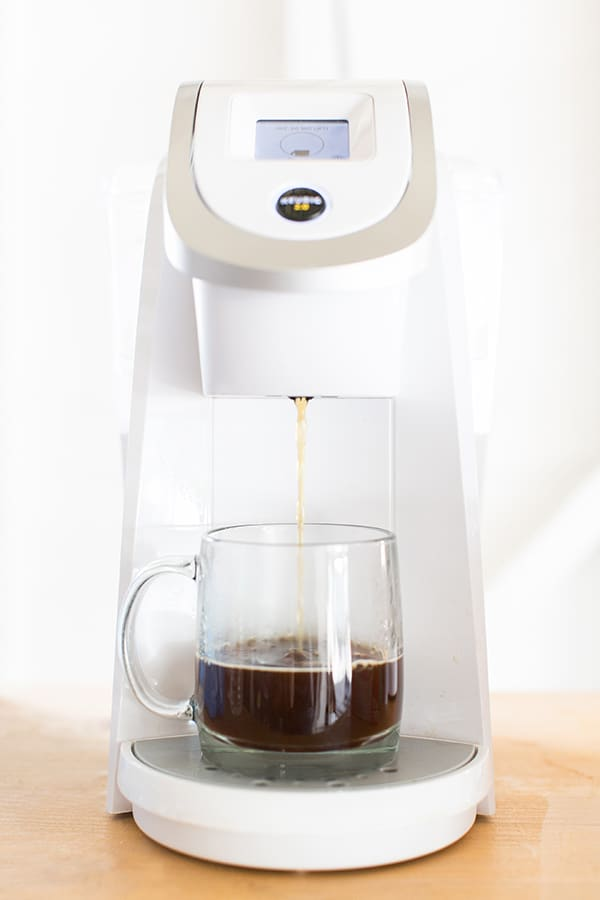 Keurig brewing coffee into a mug