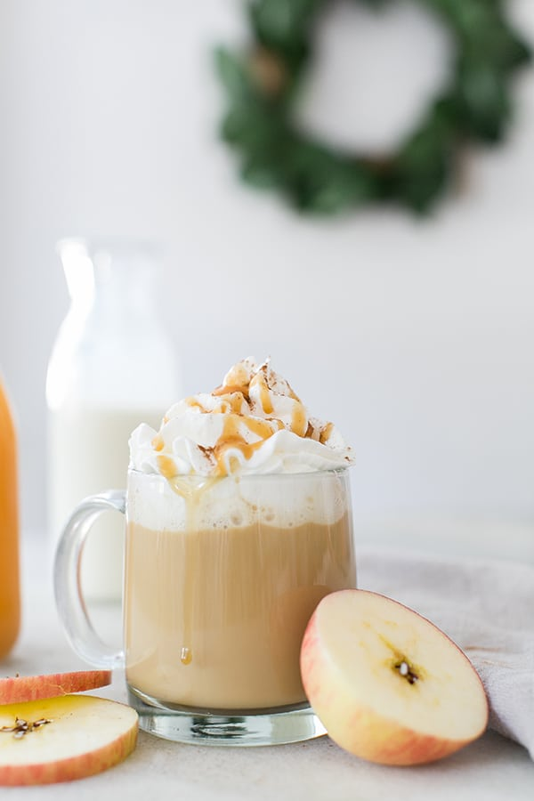 Apple pie coffee with whipped cream and drizzled with caramel and spices.