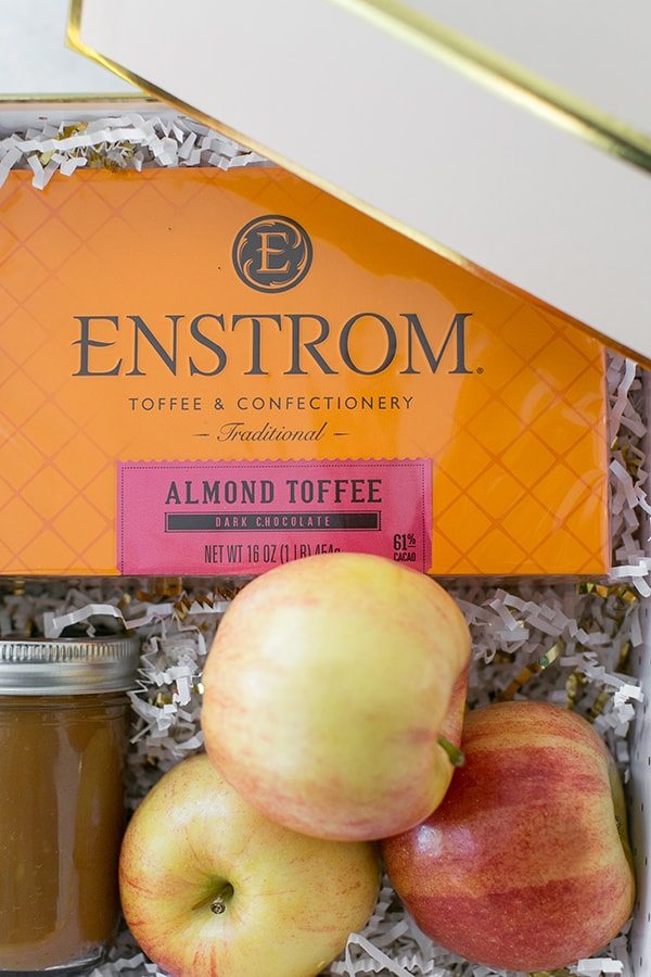 Enstrom almond toffee in an orange box with apples.
