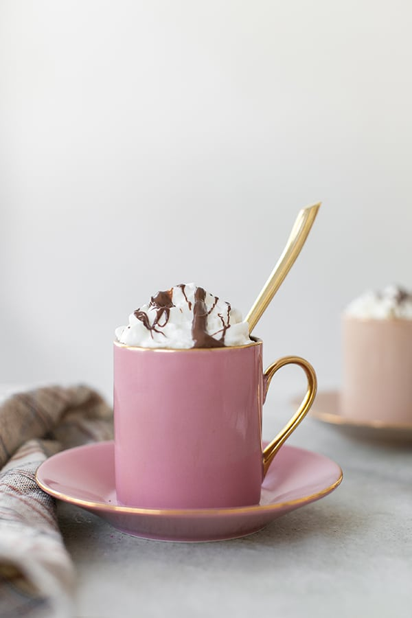 Hazelnut coffee in a pink mug.