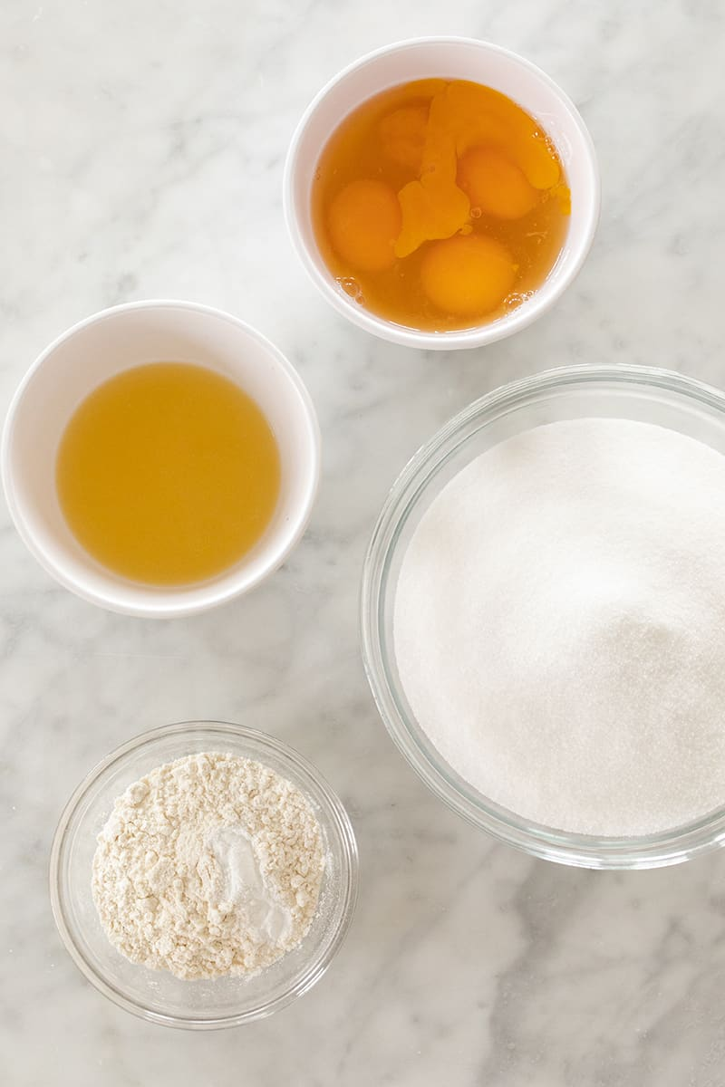 Lemon juice, sugar and flour to make lemon bars.