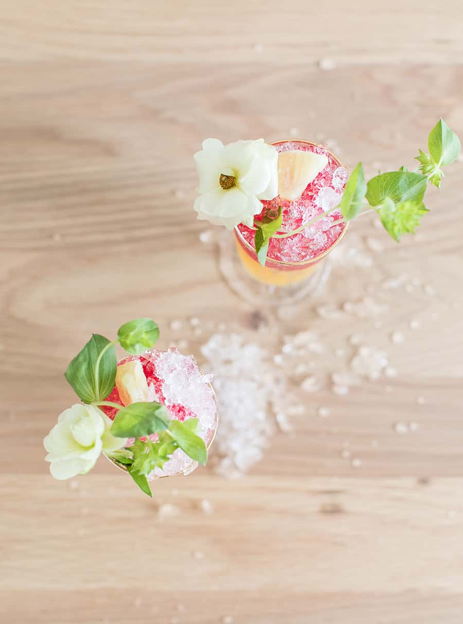 Pineapple tequila cocktail with flowers and pineapple
