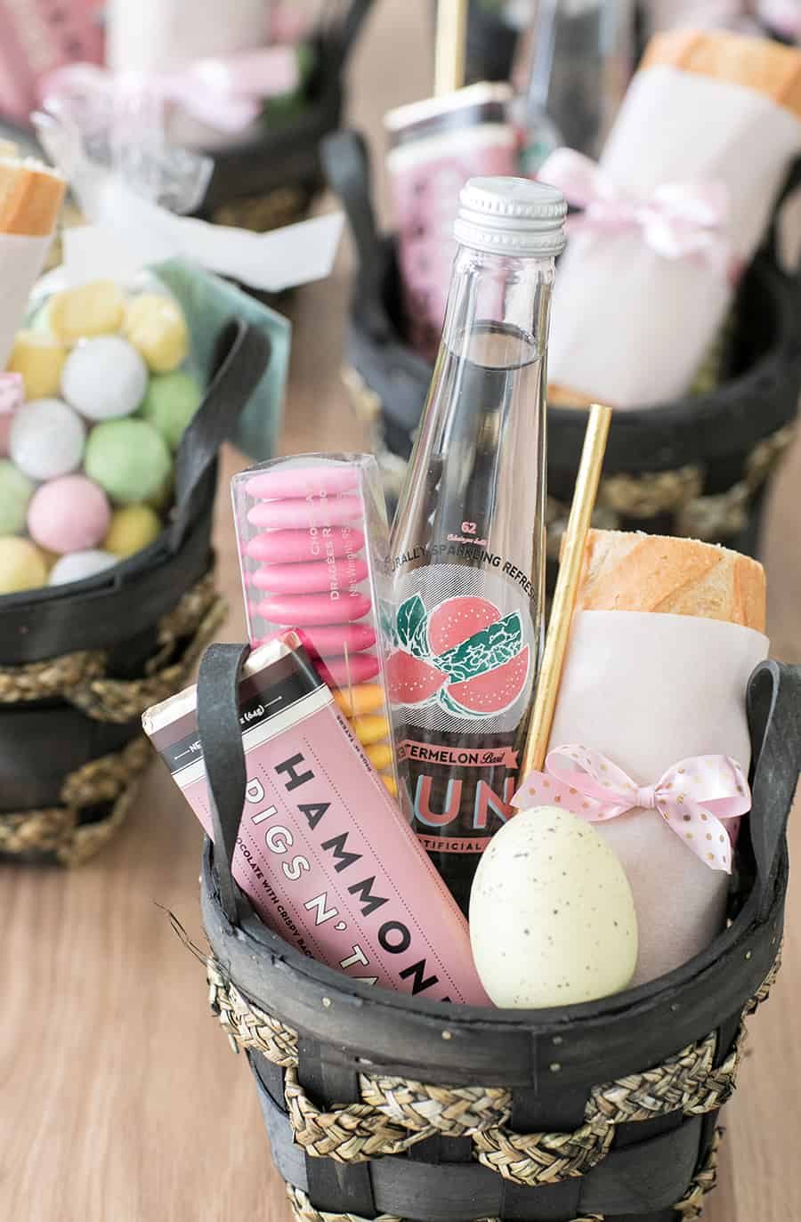 Mini Easter baskets filled with chocolate, water, bread and an Easter egg.
