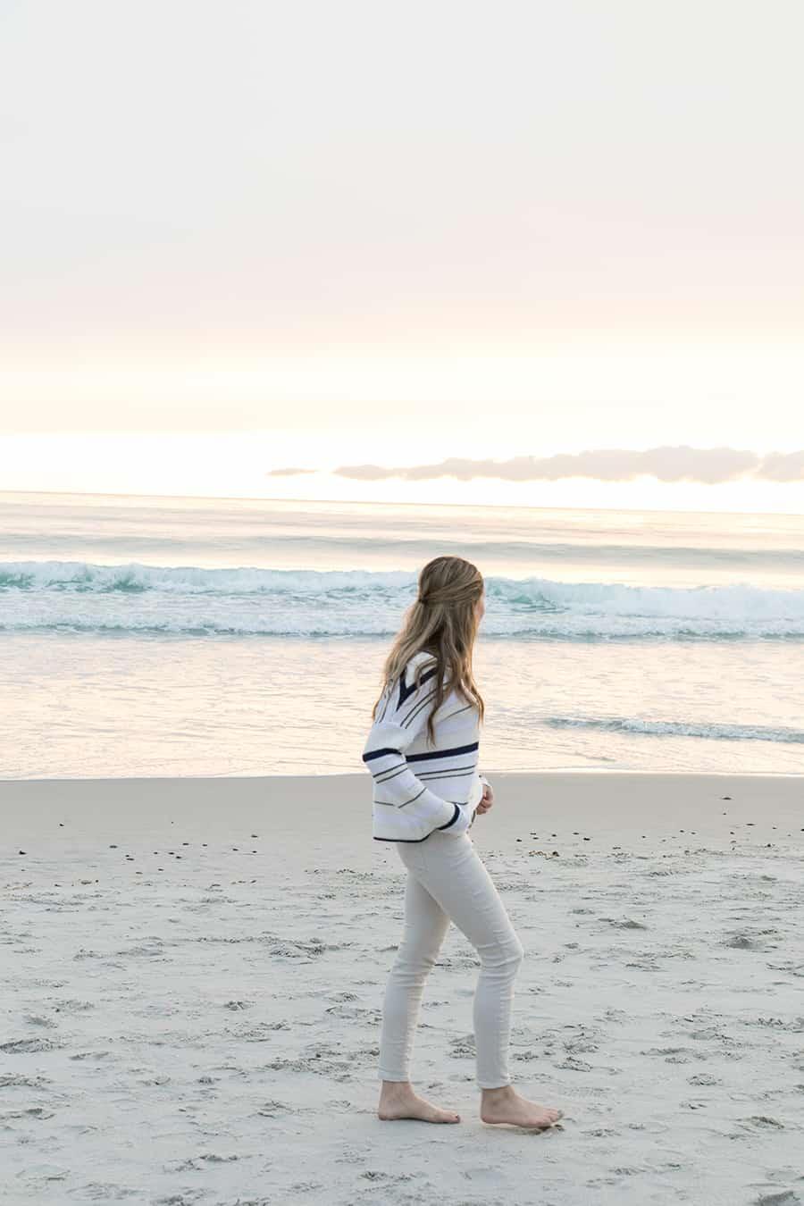 Eden Passante walking on the beach in Carmel