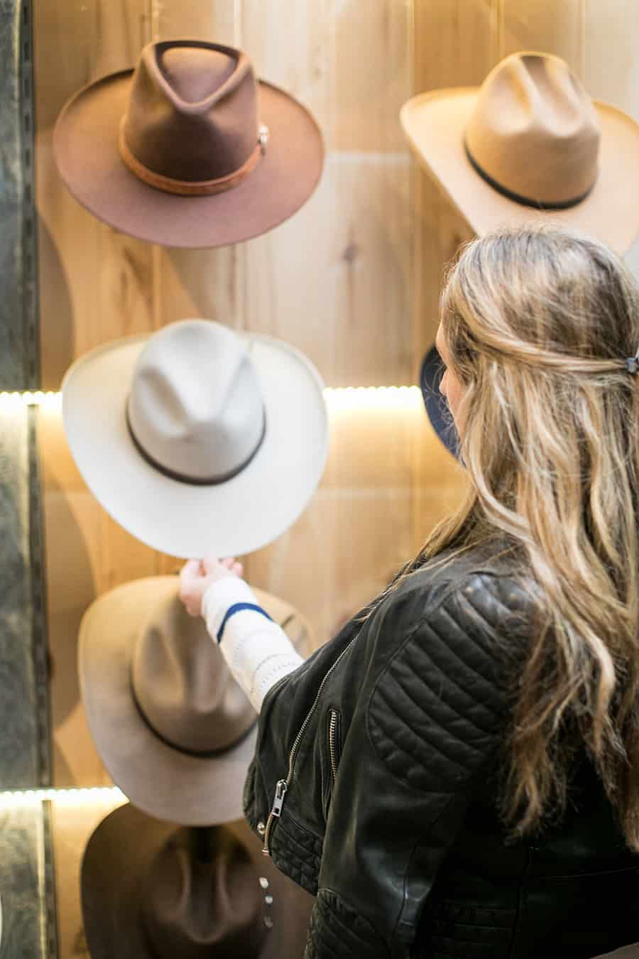 Eden Passante picking out hats shopping in Carmel