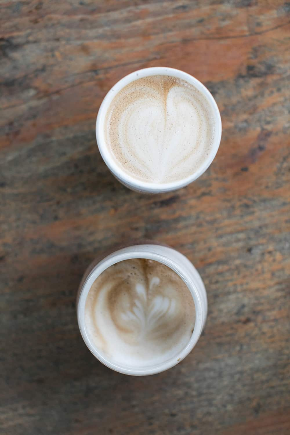 Two lattes on a wooden table