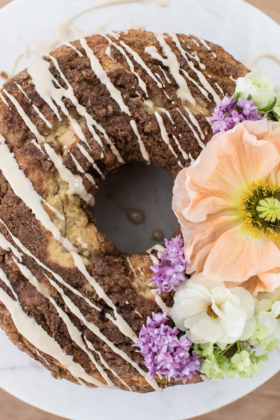 close up of moist coffee cake with flowers on it